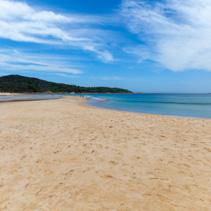 Scenic panorama of narrow sandy passage to Fingal island. Fingal Bay, New South Wales, Australia