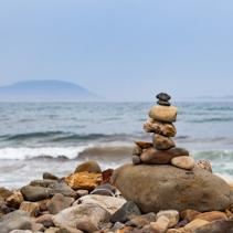 Stone cairn on ocean shore in Australia