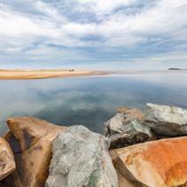 Calm waters of Manning River viewed from Harrington Breakwall. Harrington, NSW, Australia