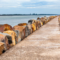 Long stretch of breakwall at Harrington, NSW, Australia