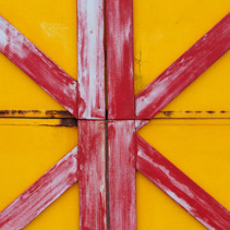 Red and yellow painted wooden planks background