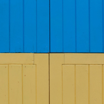 Blue and yellow wooden planks background