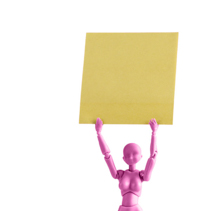 Pink female figurine holding yellow note high up above her head isolated on white with copy space