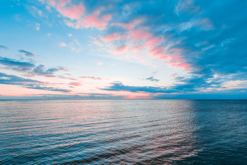 Smooth water surface in orange sunset colors