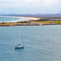 Sailboat sailing thgough Coffs Harbour, New South Wales, Australia