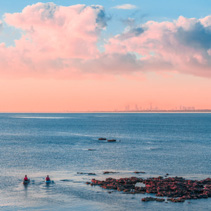 Two kayakers paddling at Mornington Peninsula