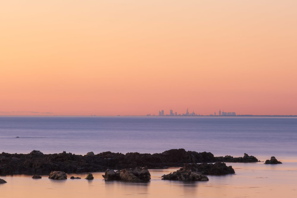 Melbourne CBD skyline at sunset in the distance