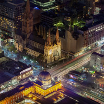 Melbourne, Australia - August 27, 2016: Aerial view of Flinders Street Station and St. Paul's Cathedral at night.