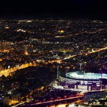 Melbourne, Australia - August 27, 2016: Aerial night view of the city and Melbourne Cricket Ground - home of Australian Football and the National Sports Museum