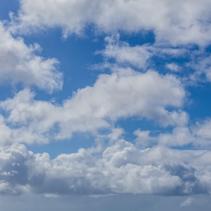 White fluffy clouds in a blue sky - beautiful cloudscape