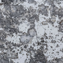 Grungy stone cement surface with peeling white paint background texture