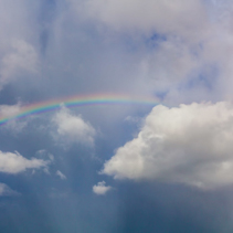 Beautiful clouds and vivid rainbow in the sky