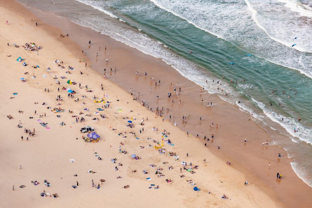 A lot of people on ocean beach - aerial view