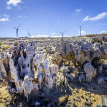 Weathered rock formations and wind turbines