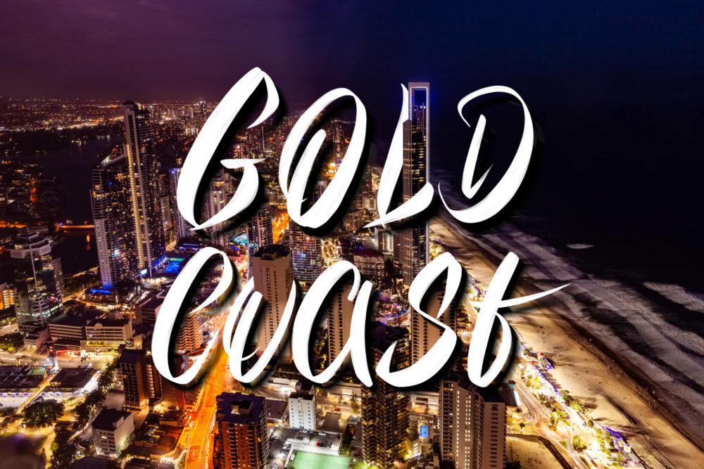 Gold Coast hand lettering over Surfers Paradise city skyline at night in Queensland, Australia