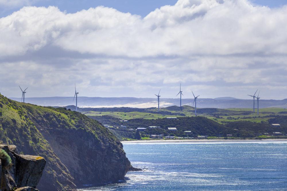 Wind farm built on rugged ocean coastline in Australia