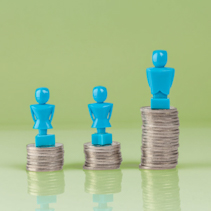 Male and female figurines standing on top of columns of coins. Wage gap concept illustration.