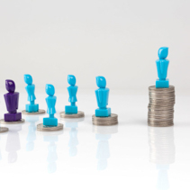 Leadership and corporate structure concept portrayed with male and femail figurines and coins.