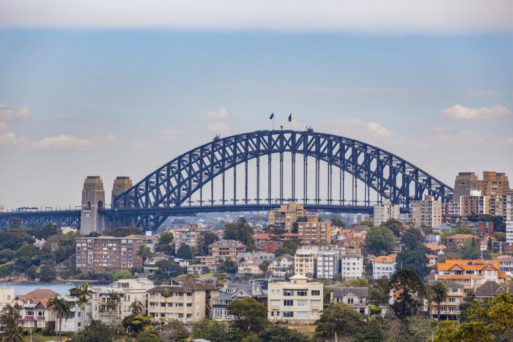 Sydney Harbour Bridge among residential buildings in Sydney, Australia
