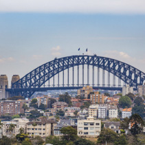 Sydney Harbour Bridge among residential buildings in Sydney, Australia
