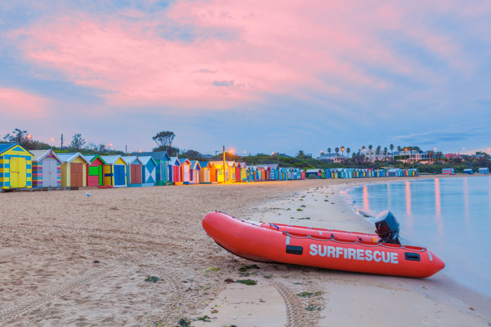 Rescue boat on a beach with huts