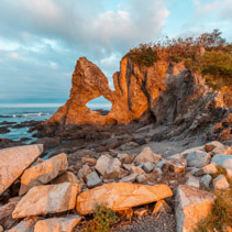 Beautiful Australia Rock at Narooma, NSW, Australia glowing in orange sunset