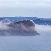 Lion Island under low clouds at Broken Bay. Sydney, New South Wales, Australia
