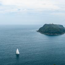 Sailboats sailing around Barrenjoey Head Lighthouse in misty weather. Sydney, Australia