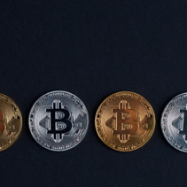 Four bitcoins on black background with copy space