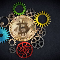 Golden bitcoin glowing among colorful cog wheels on black background with copy space. Cryptocurrency is the future - concept