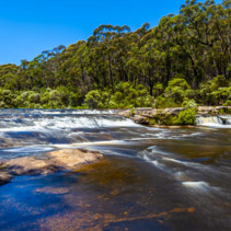 Water flowing in Kangaroo river towards Carrington Falls. New South Wales, Australia