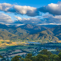 Aerial panorama of Mount Beauty town and pondage at sunset. Kiewa valley, Victoria, Australia