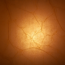 Light glowing behind cracked rice paper background texture overlay