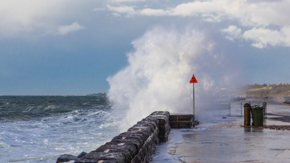 Big wave breaking over pier