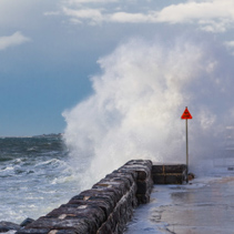 Big wave breaking over pier