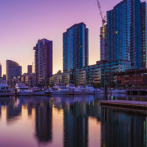 Docklands, Melbourne high rise residential buildings and moored yachts at dawn