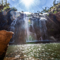 Sun shining brightly on Mackenzie falls in Grampians