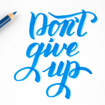 Don't give up - quote lettering in blue on white background