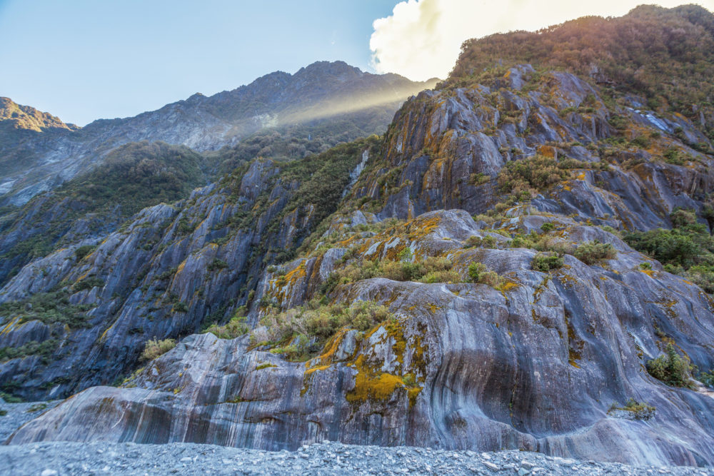 Beautiful curvy rock formations carved by the retreat of Franz Josef Glacier