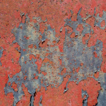 Beautiful grungy paint peeling from rusty metal background texture