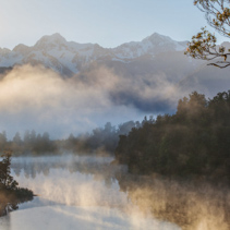View of Southern Alps from lake Matheson in the early morning mist