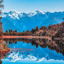 Twin Peaks reflect in the beautiful Lake Matheson, New Zealand