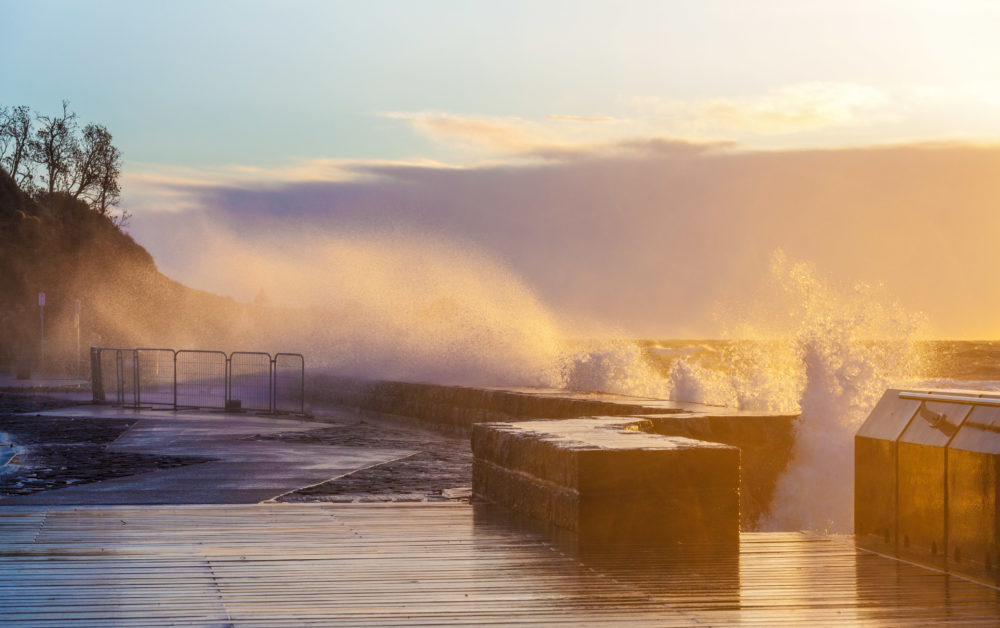Waves crushing with force on Mornington Pier
