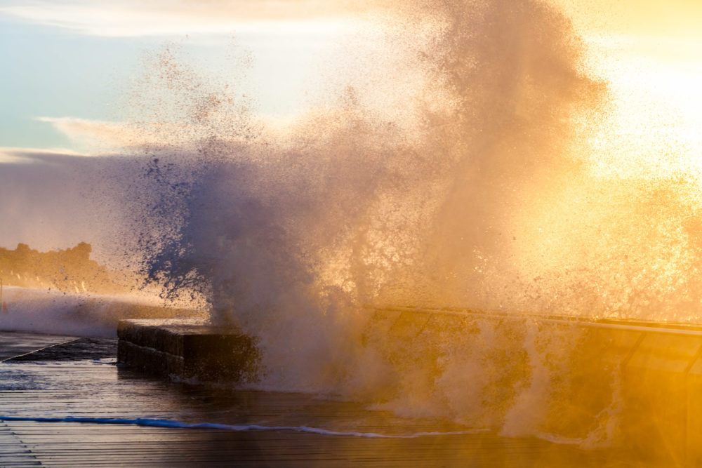 Huge waves crushing with force on Mornington Pier
