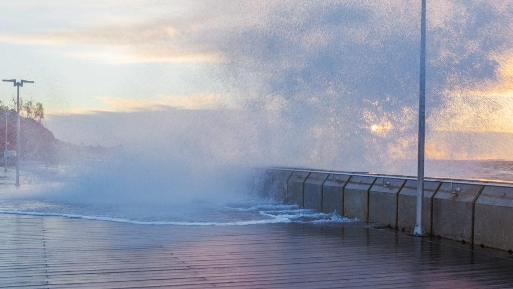 Huge wave breaks and splashes