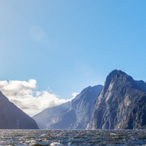Majestic snow capped peaks of Milford Sound with sun rays. Fiordland, New Zealand