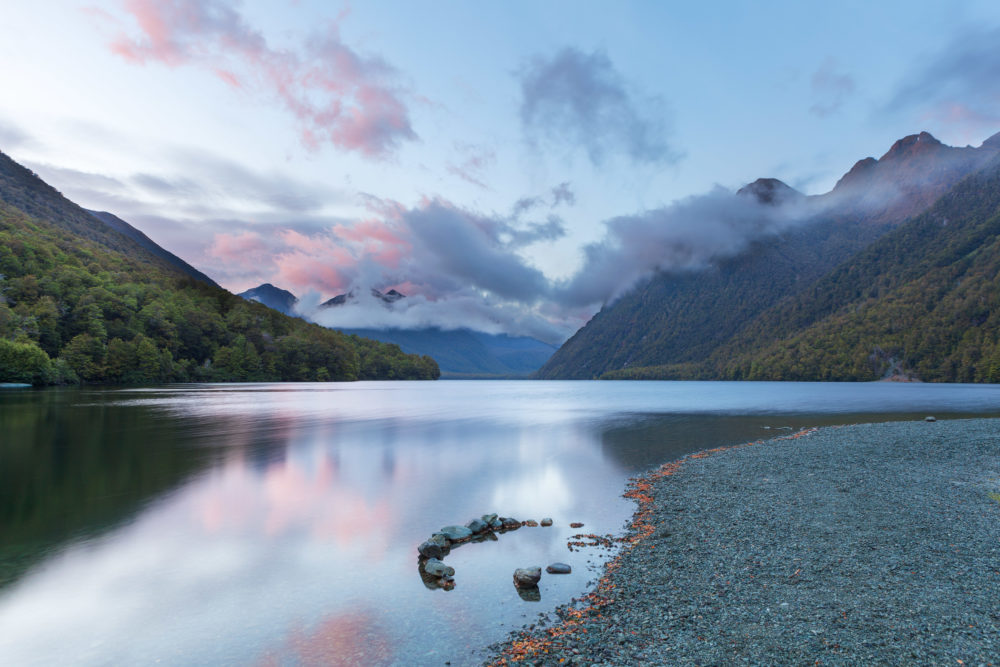 Lake Gunn at sunrise with reflections, Fiordland, South Island, New Zealand