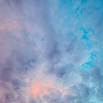 Looking straight up at clouds at colorful sunset