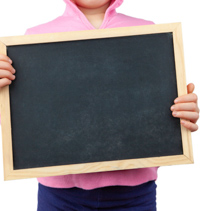 Child on white background holding empty blackboard with copy space
