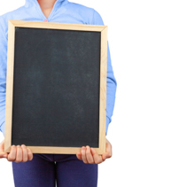 Child on white background holding empty blackboard vertically with copy space